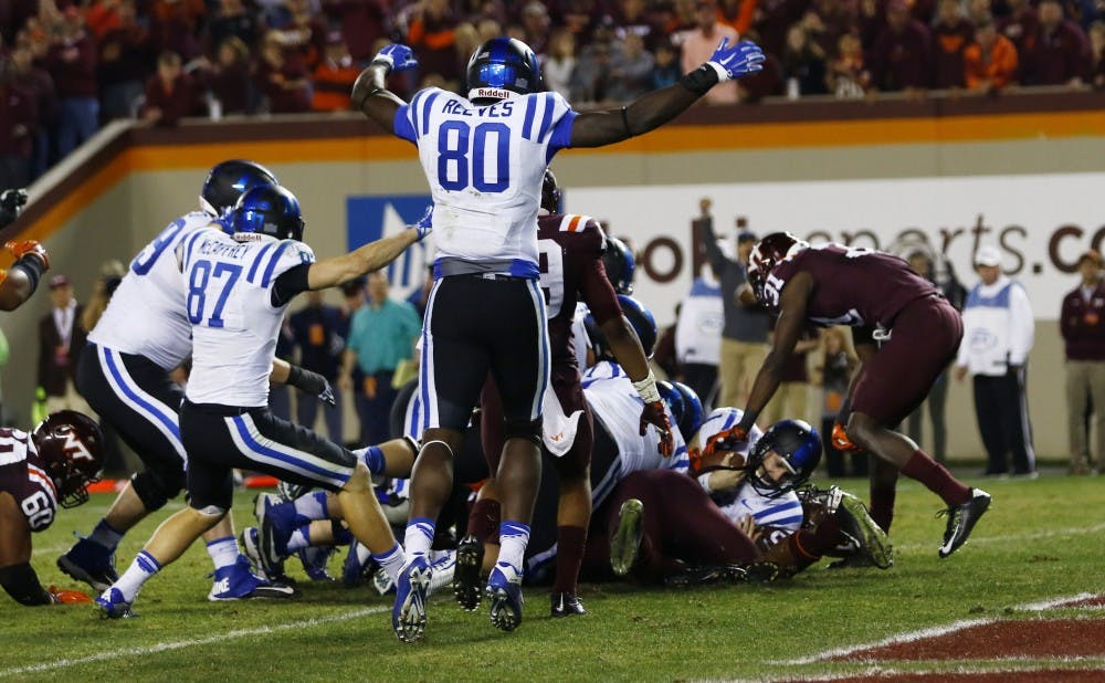 <p>Quarterback Thomas Sirk's scamper in quadruple overtime gave No. 23 Duke a 45-43 win in a wild game Saturday on the road.</p>