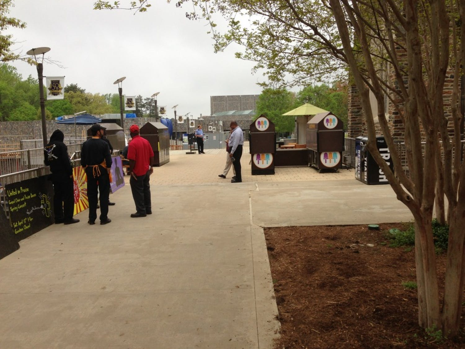 Employees wait outside the Bryan Center Tuesday morning as police investigate a bomb threat.