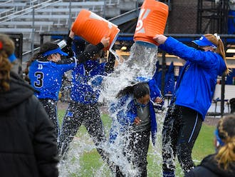 The team gave head coach Marissa Young a classic Gatorade shower after securing the 100th win in program history Saturday.