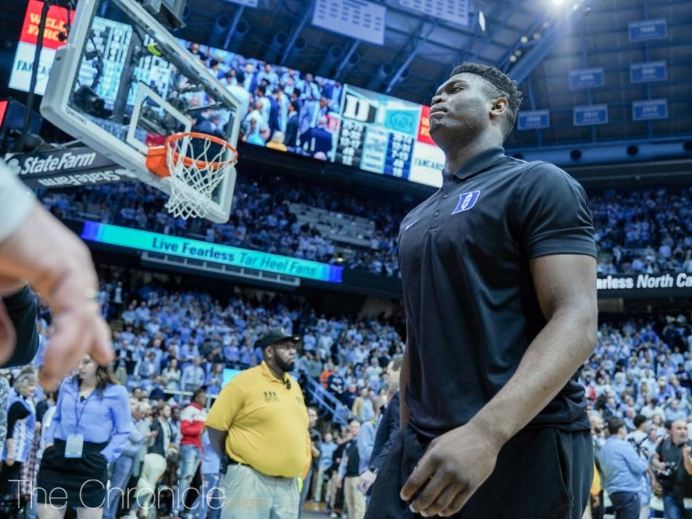 Zion Williamson walks on the court at a game against North Carolina in March 2019.