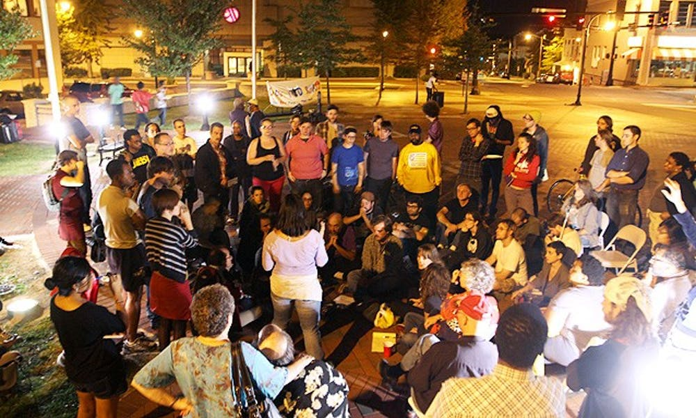 A group of approximately 75 protestors gathered in downtown Durham with the intention to camp out, but city officials disallowed it.