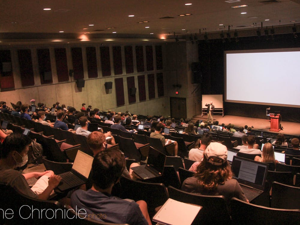 Connel Fullenkamp, professor of the practice of economics, teaches Economics 101 in the Griffith Film Theater Aug. 17.