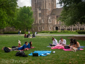 Friends studied on the quad, enjoying for their last two weeks together before they head home for the summer.
