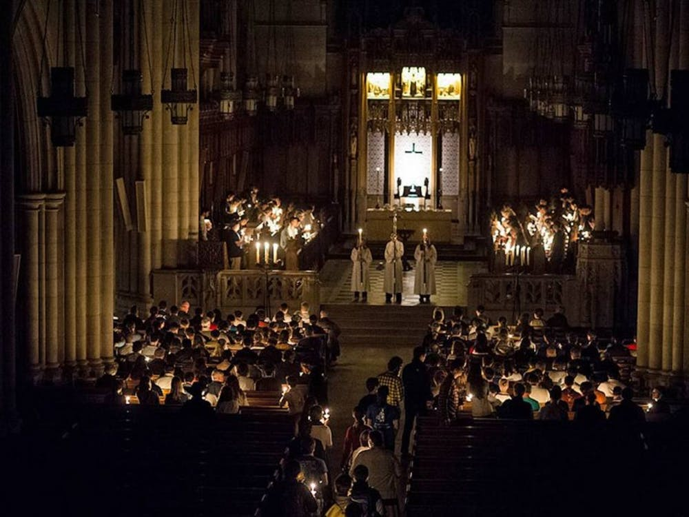 Worshipers at Duke Chapel participate in the All Hallows' Eve service, which takes place by candlelight Oct. 31.