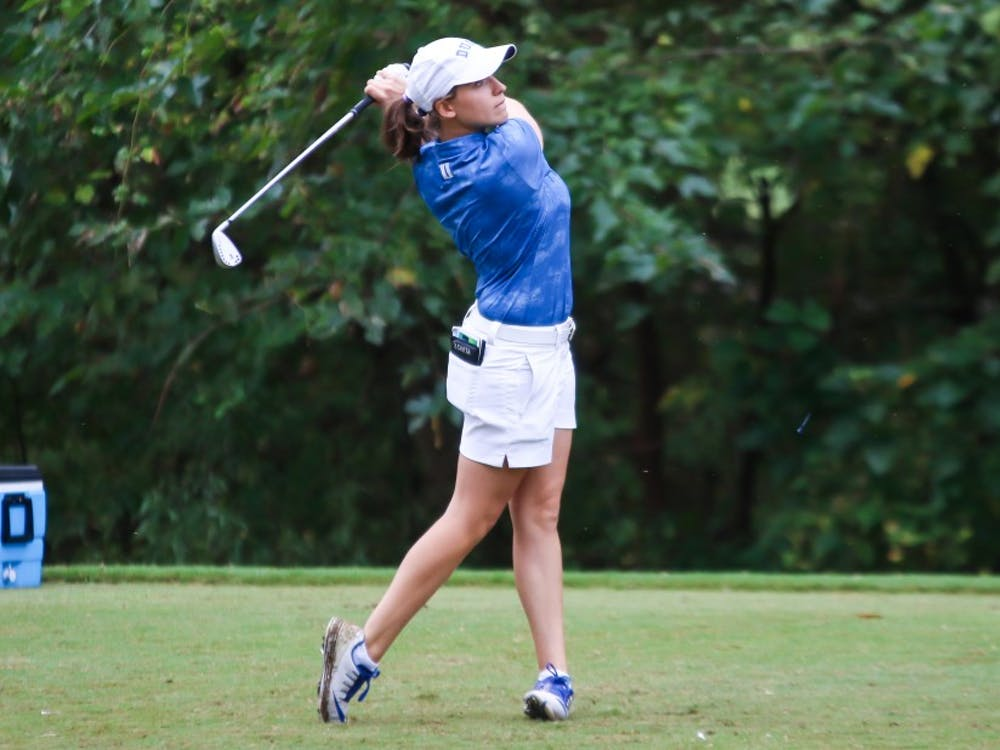 Virginia Elena Carta tied for the individual title with teammate Gina Kim.