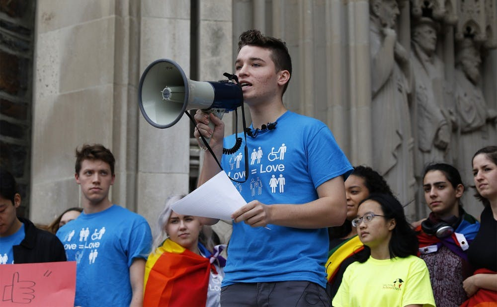 <p>Freshman Jack Donahue spoke at a gathering Friday in response to a death threat including a homophobic slur written on the first floor of his residence hall.</p>