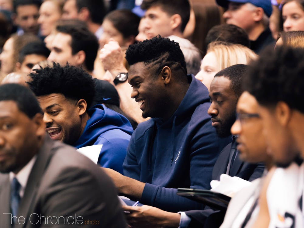 Zion Williamson enjoyed the company of two NCAA champions, Quinn Cook and Tyus Jones, at Duke's win.
