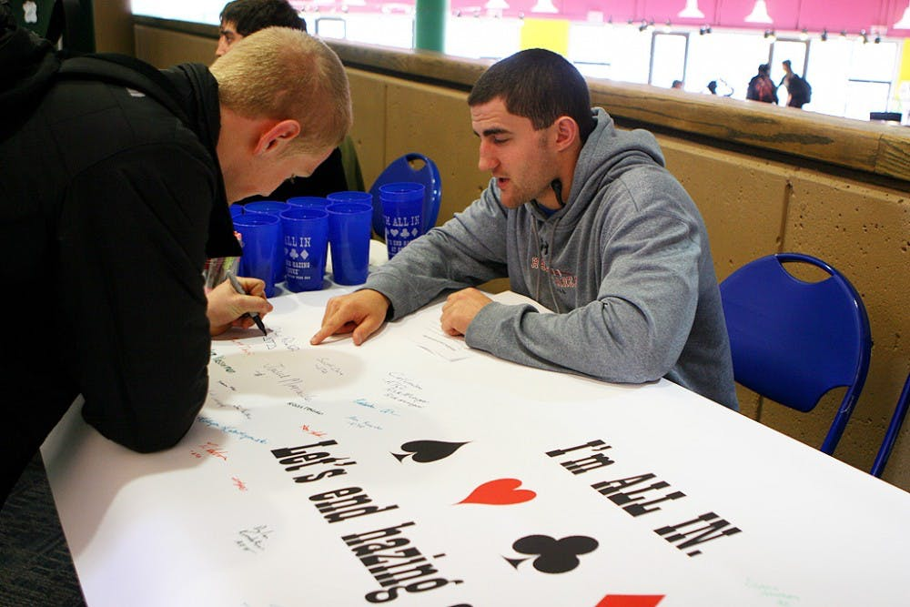 Students sign an anti-hazing pledge in the Bryan Center Monday, as part of an initiative organized by the Hazing Prevention Coalition.