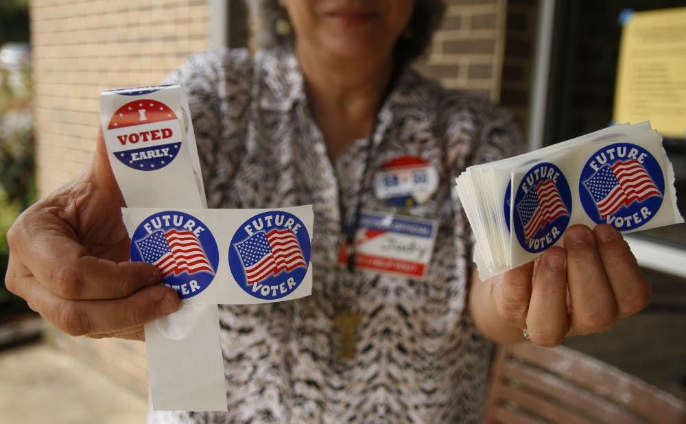 <p>Members of the Duke community cast ballots Thursday at the Devil's Den,&nbsp;one of 13 locations currently open in Durham County for early voting from Oct. 27 to Nov. 5</p>