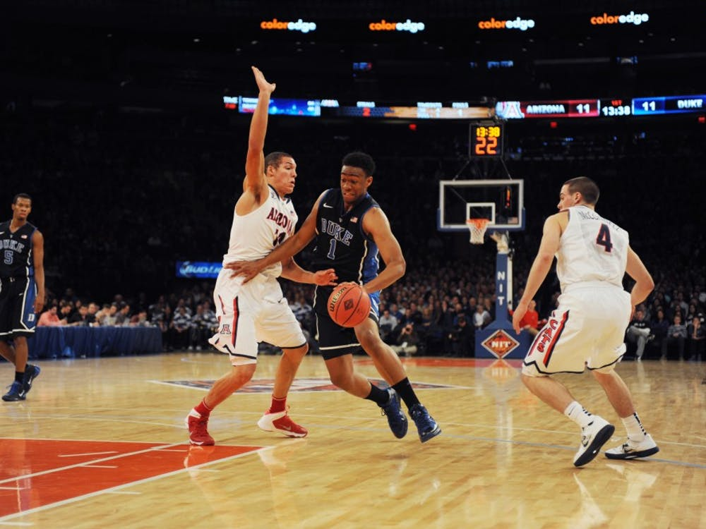 Freshman Jabari Parker struggled against Arizona's defense, notching 19 points on 21 shots in a 72-66 loss.