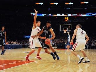 Freshman Jabari Parker struggled against Arizona's defense, notching 19 points on 21 shots in a 72-66 loss.