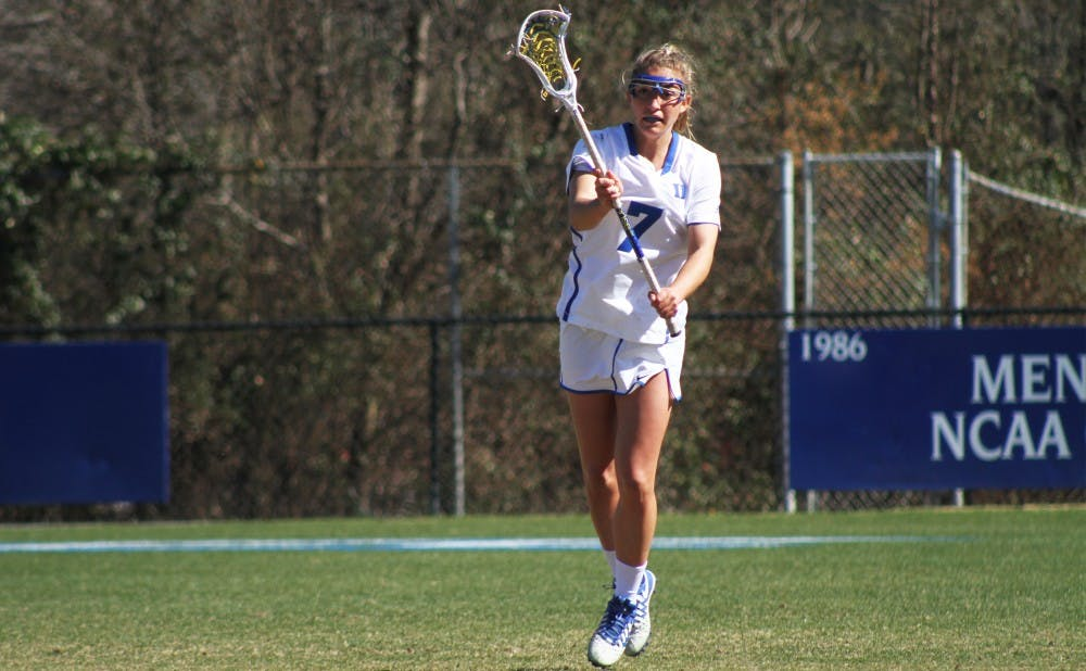 <p>Senior Maddy Acton scored a career-high six goals Sunday, but the Blue Devils could not dig out of an 11-5 halftime deficit against No. 4 Syracuse.</p>