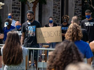 Senior Mike Buckmire was one of many speakers to take the stage at an August protest in Krzyzewskiville.