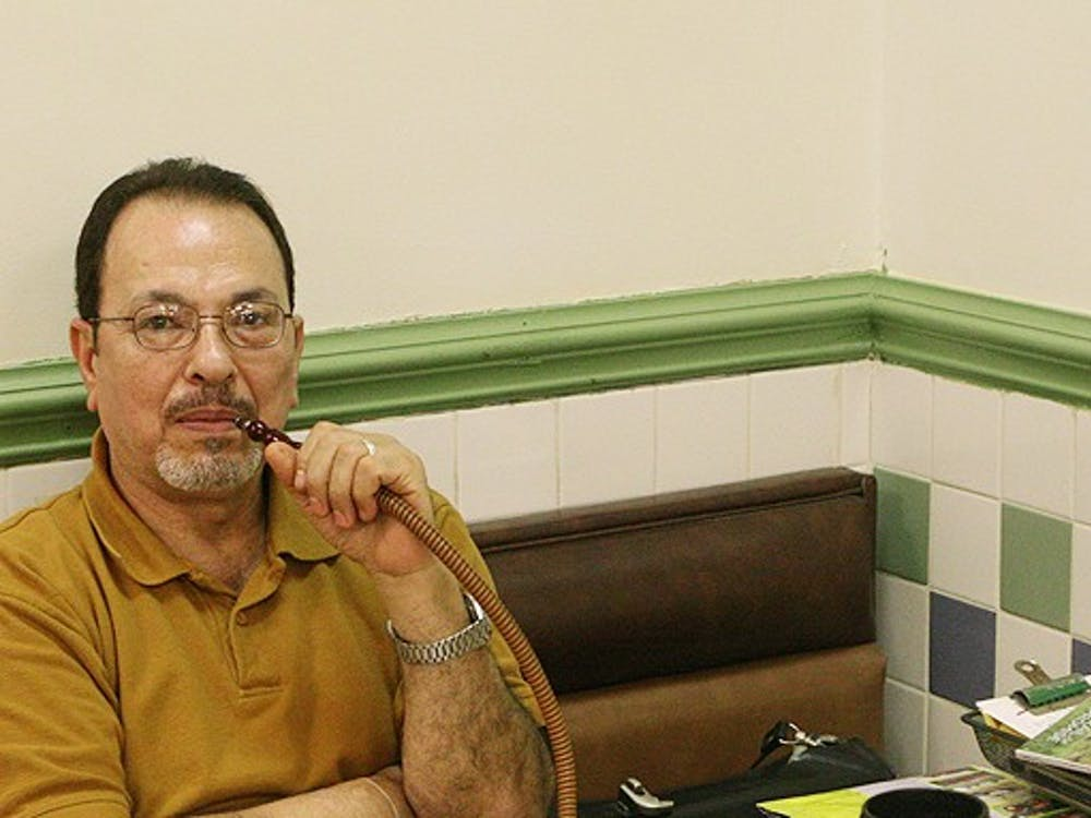 Enjoying a hookah inside his restaurant, International Delights owner Gehad Lobbad said the new statewide smoking ban in restaurants and bars will have a negative impact on the local businesses.