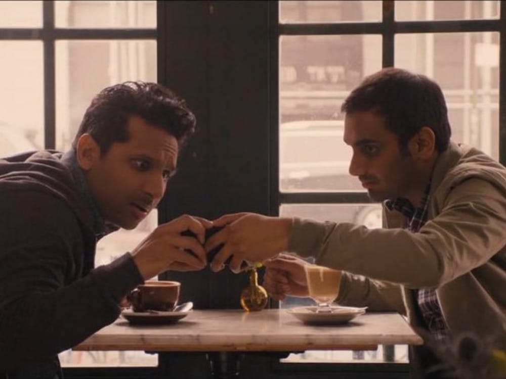 """As Dev (right), Aziz Ansari brings out the subtle humor of everyday life in Season 2 of Netflix's""""Master of None."""""""