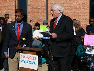 Rep. David Price, a Democrat from North Carolina's fourth congressional district, spoke with refugees at an event at Smith Warehouse in 2017.