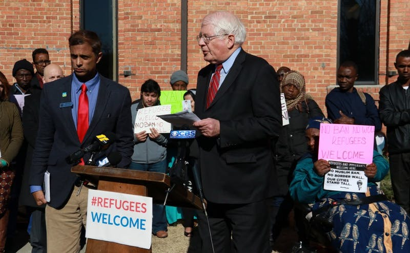 Rep. David Price, a Democrat from North Carolina's fourth congressional district, spoke with refugees at an event at Smith Warehouse Monday afternoon.