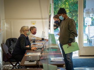 A voter checks in at the 5th precinct voting site in Durham at the W.I. Patterson Community Center.