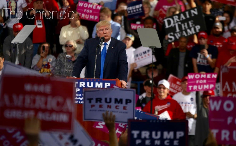 <p>Long before he became president, Donald Trump took in a Duke-North Carolina game courtside like many celebrities had before him.&nbsp;</p>