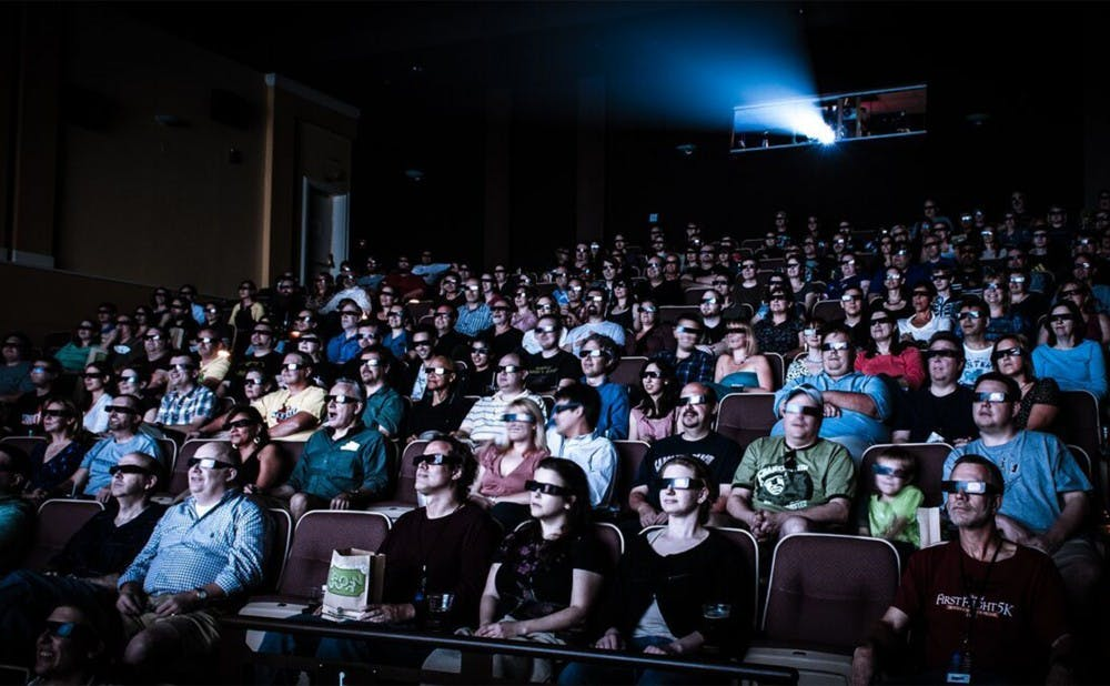 "<p>Viewers watch a film showing at the Carolina Theatre, where the ""Retro Film Series"" is being shown this season. </p>"