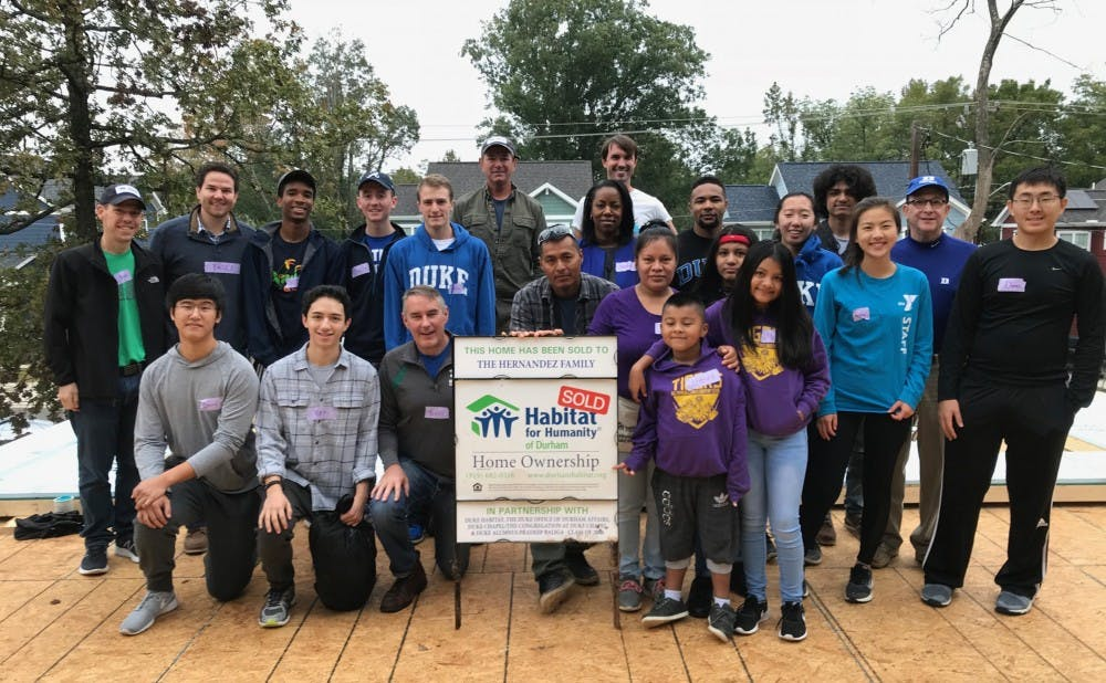 A main focus of the Duke-Durham Neighborhood Partnership is affordable housing, with both students and staff helping to build homes for Habitat for Humanity.