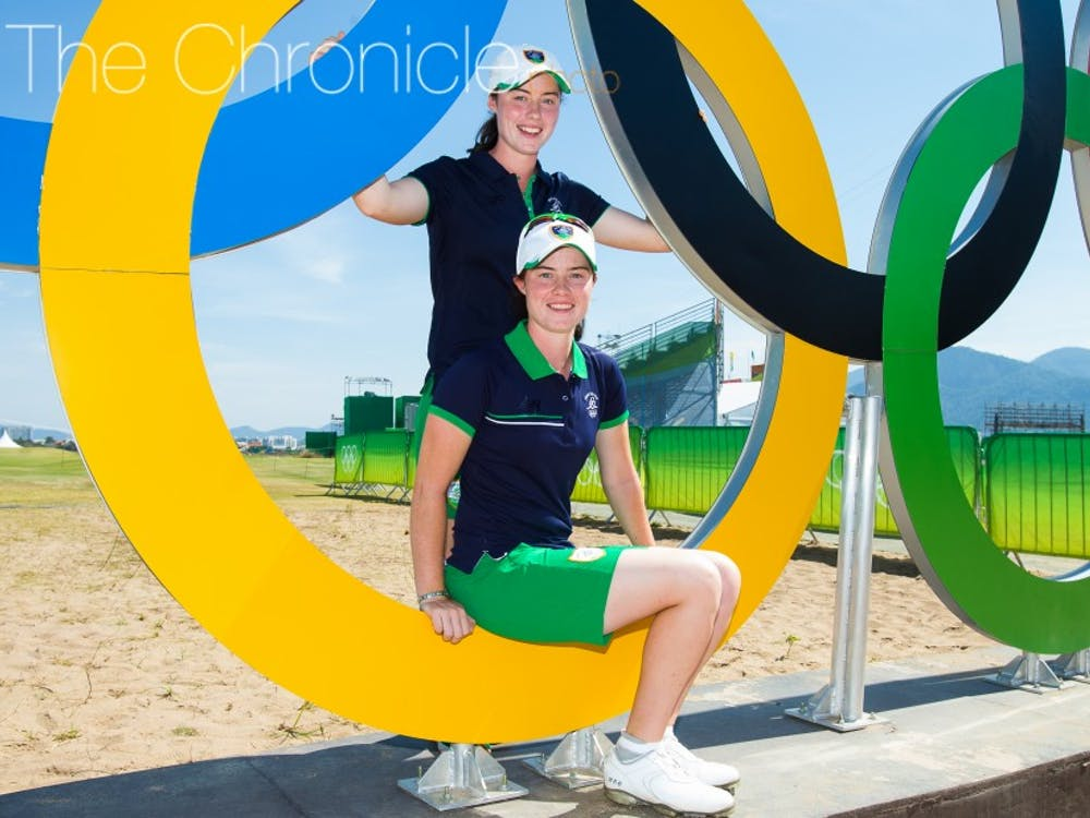 RIO DE JANEIRO, BRAZIL - 16/08/2016: Leona Maguire of Ireland with her sister and caddie for the week, Lisa pose for a photo with the Olympic rings during the Monday Practice round at the Rio 2016 Olympic Games, Reserva de Marapendi Golf Course, Barra Da Tijuca, Rio De Janeiro, Brazil. (Photo by Tristan Jones/IGF)