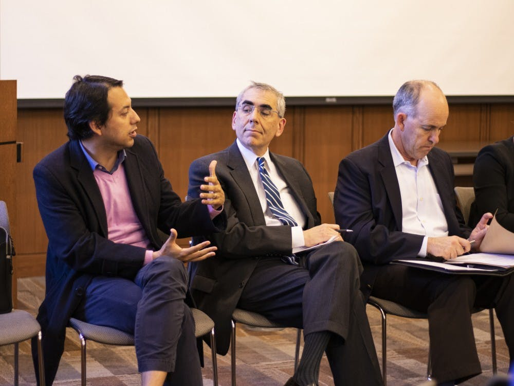 <p>From left to right: Edgar Virugez, doctoral candidate in the Nicholas School; Michael Schoenfeld, vice president of public affairs and government relations; David Kennedy, vice president of alumni affairs and development.</p>