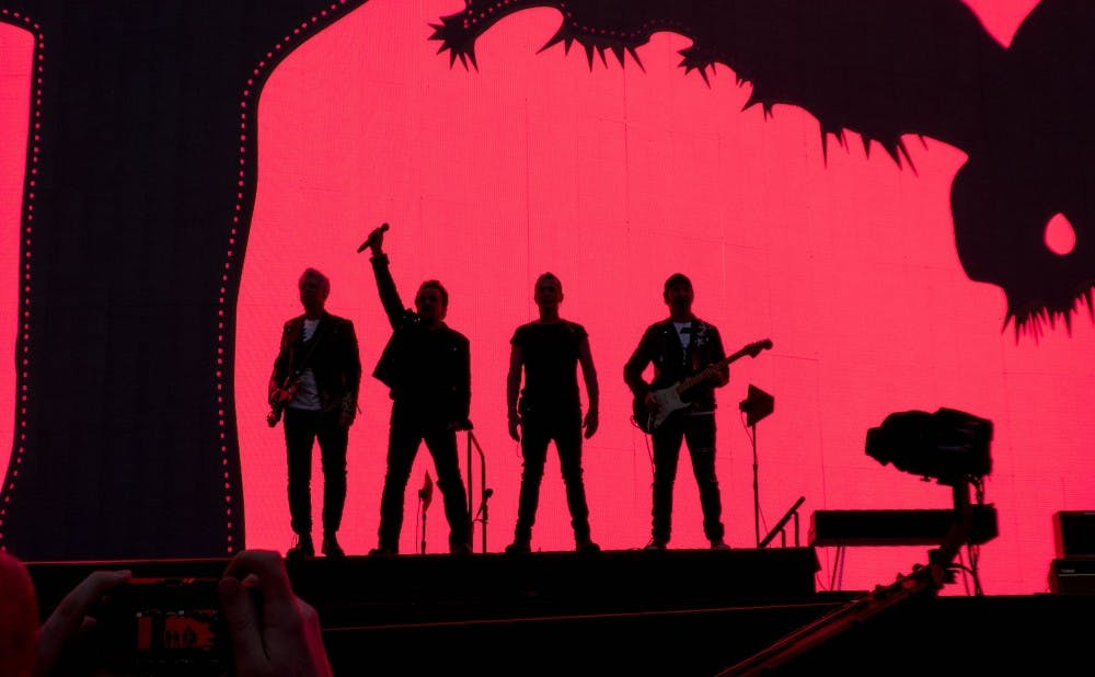 U2_against_red_video_screen_Joshua_Tree_Tour_2017_Dublin_7-22-17