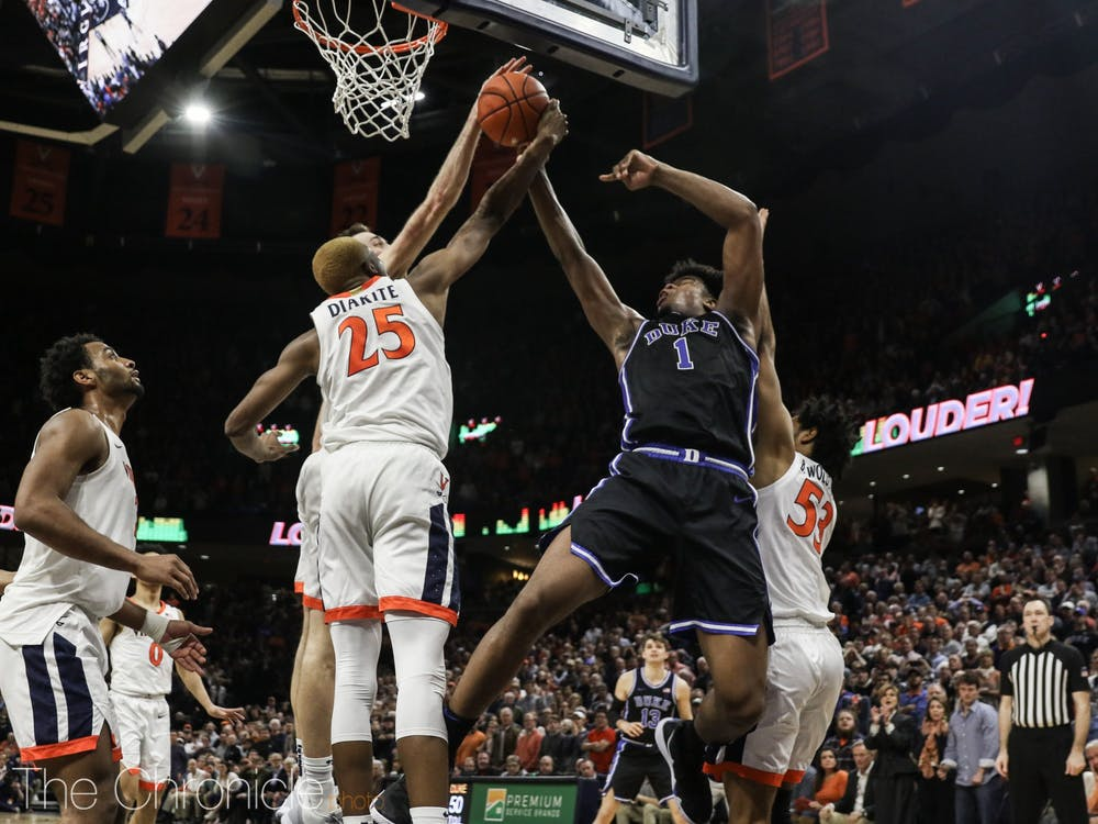 <p>Vernon Carey Jr.'s potentially game-winning shot in the waning seconds was blocked by Virginia's Jay Huff.</p>
