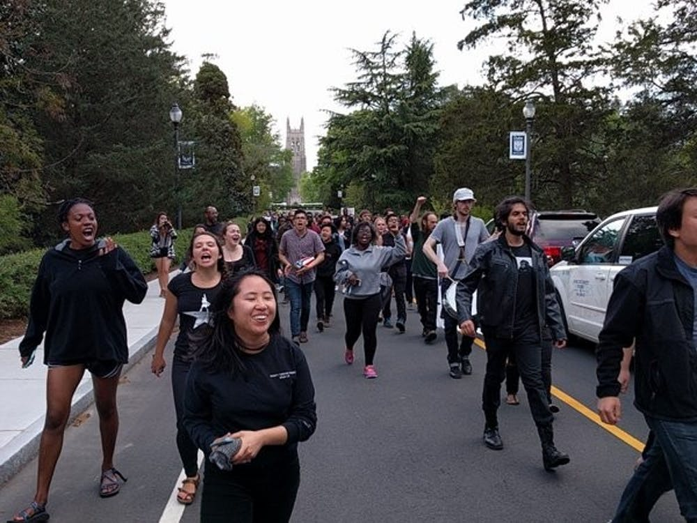 Protestors marched down Chapel Drive after exiting the Allen Building.