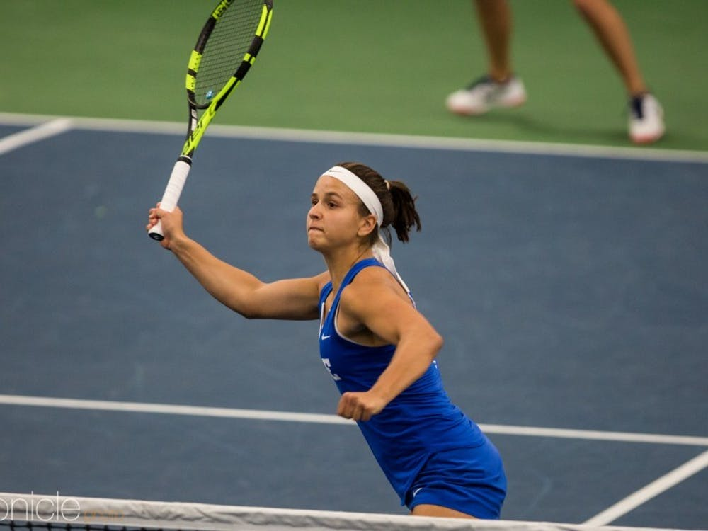 Samantha Harris cruised in singles for her 10th win against a ranked opponent of the season.