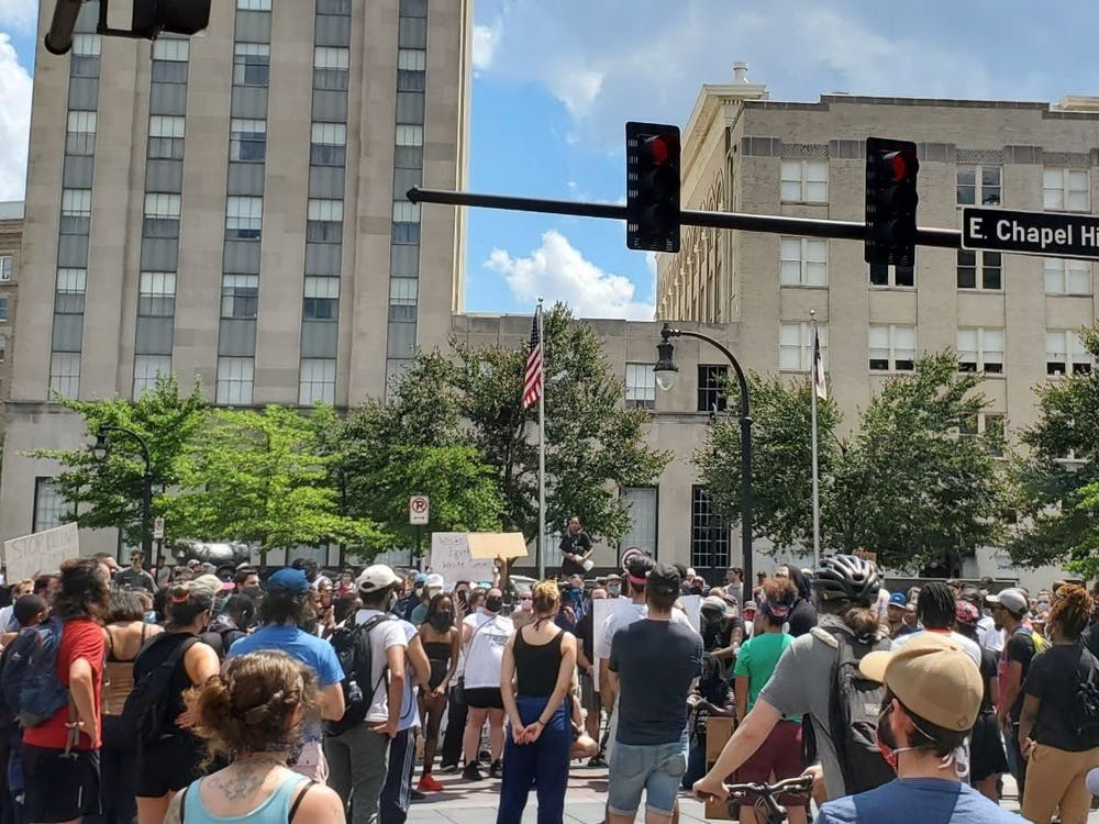 A May 30 protest in Durham against racism and police brutality. Duke students recounted leading chants, speaking and running from tear gas at similar events across the country.
