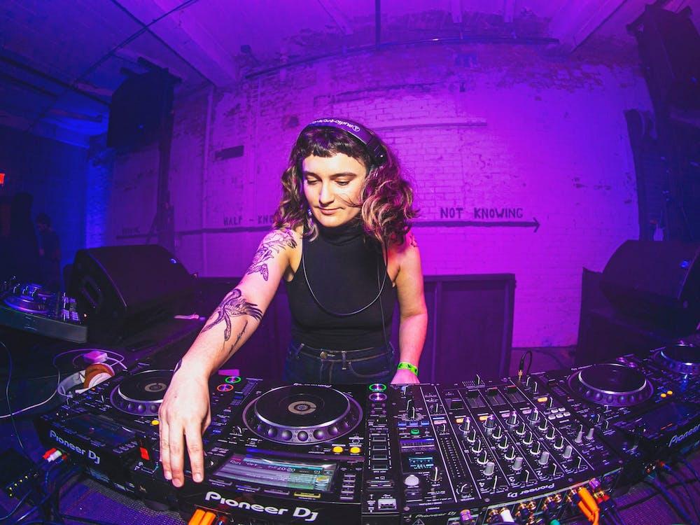 <p>Sarah Damsky DJing at The Fruit in December 2019.</p>