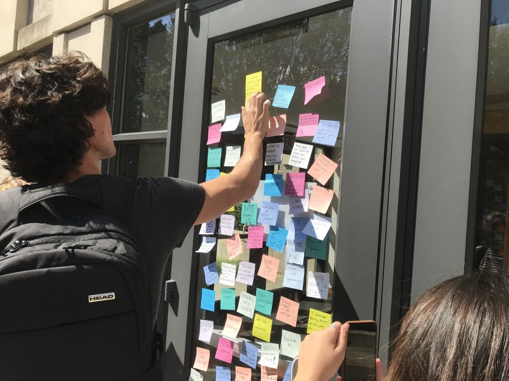 Organizers encouraged students to express their feelings on post-its pasted on the Sanford Building.