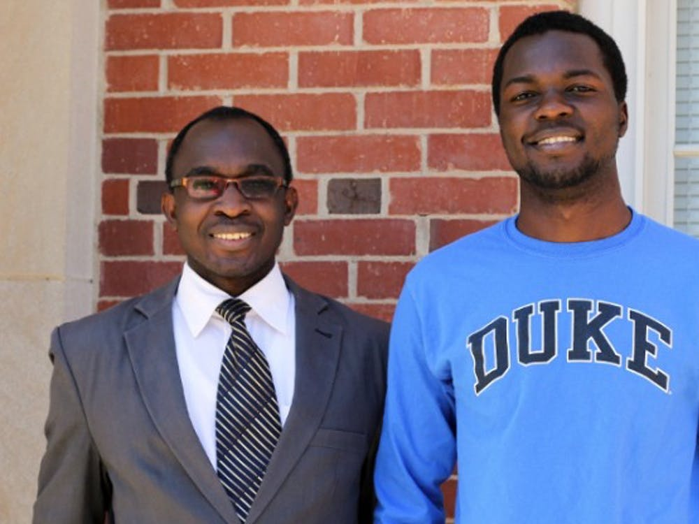 Kenneth Rubango (right) and Henry Kiwumulo (left) received full scholarships to study biomedical engineering at Duke.