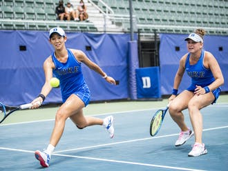 Meible Chi and Margaryta Bilokin won their doubles match to secure the doubles point for Duke.