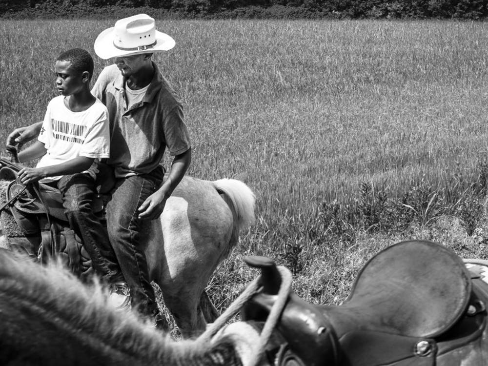 """""""Father and Son,"""" (Cecilia, LA) 2015. """"Louisiana Trail Riders"""" is on display at the Center for Documentary Studies until Sept. 22."""
