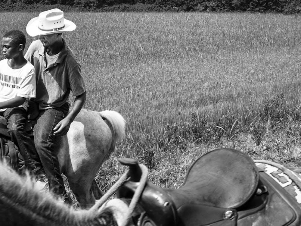 """Father and Son,"" (Cecilia, LA) 2015. ""Louisiana Trail Riders"" is on display at the Center for Documentary Studies until Sept. 22."