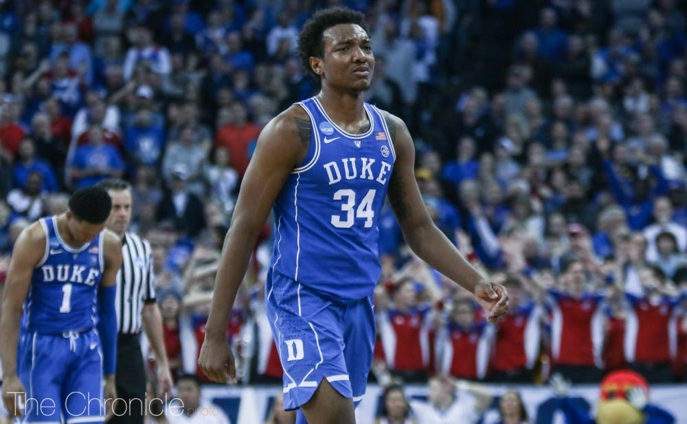 Wendell Carter Jr. fouled out in overtime on a blocking foul with Malik Newman driving.