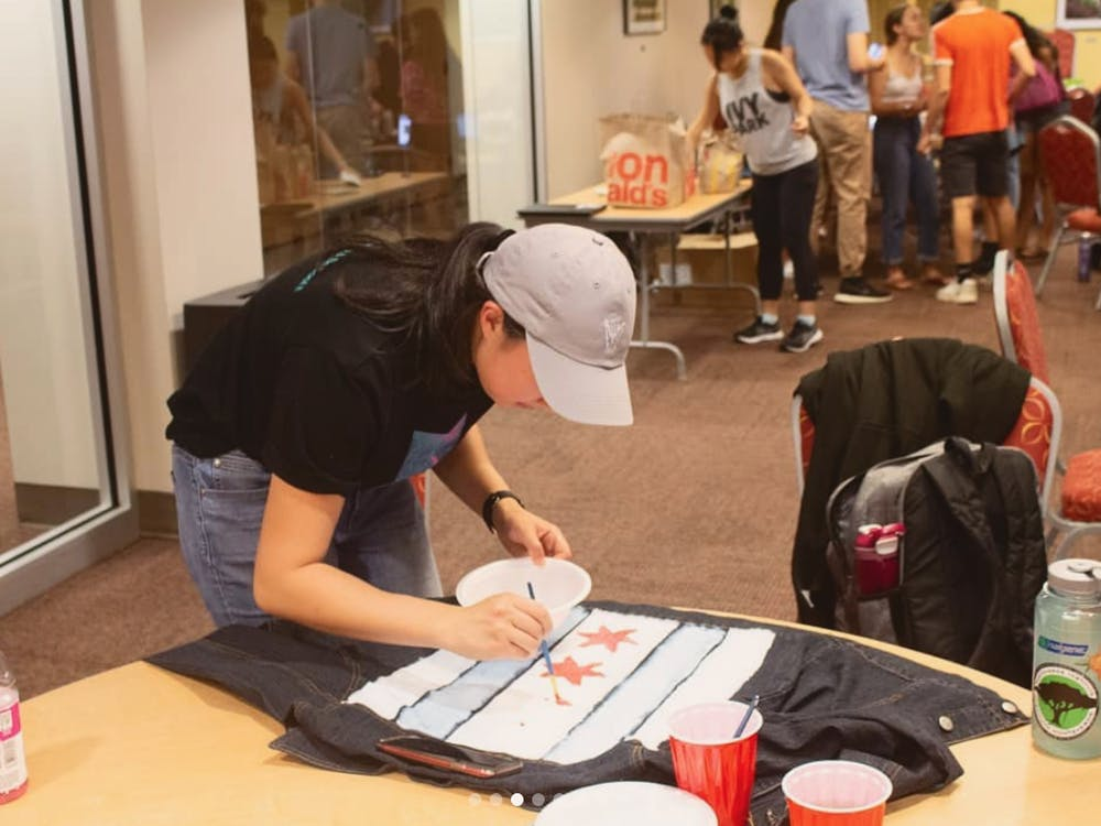 "<p>Duke Fashion Exchange holds events such as ""upcycle painting,"" in which painted designs give old clothes new lives.</p>"