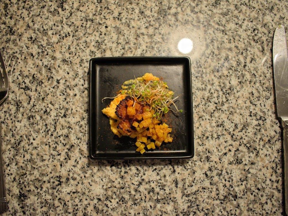 Scallop, pureed butternut squash, butternut squash, broccoli microgreens