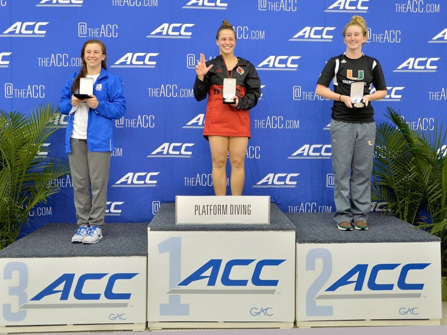 Louisville's Andrea Acquista, first, Miami's Wally Layland, second, and Duke's Maryellen Targo place in the platform diving during the ACC Diving and Women's Swimming Championships in Greensboro, N.C., Saturday, Feb. 20, 2016. (Photo by Sara D. Davis, the ACC.com)