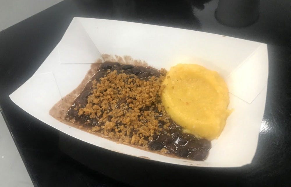 Vegan Flava doesn't sacrifice flavor in its vegan, plant-based creations, including these Daiya cheese grits and black beans with walnut topping.