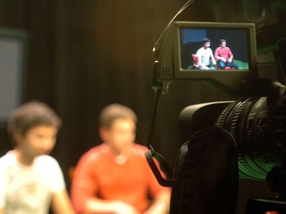 Cable 13, shown filming a show, is revamping its Web site to increase its online viewing audience. The new site will also allow students to submit their own videos.