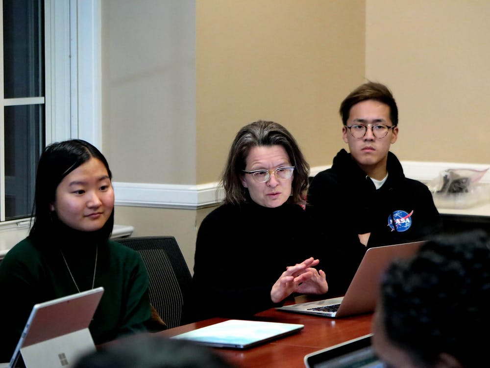"""Professor Jocelyn Olcott, center, and her Bass Connections team have worked with researchers around the world to look at the potential for a """"global care index"""" to rate countries on how they value all forms of care."""