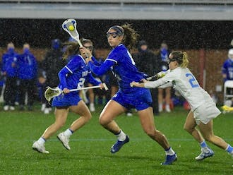 Duke and North Carolina braved heavy rain and bitter cold in their first meeting of the season Friday night.