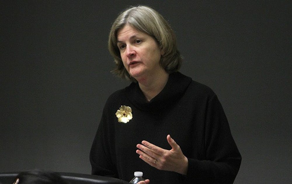 Nancy Andrews, dean of the School of Medicine, talks to students Wednesday about diseases based in genetics.