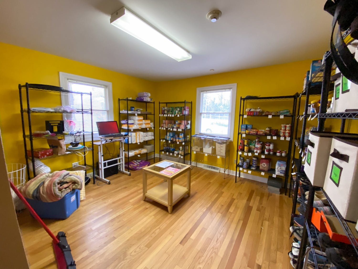 """The GPSC Community Pantry where patrons can """"shop"""" for groceries, toiletries, gently used professional wear, and childcare supplies."""