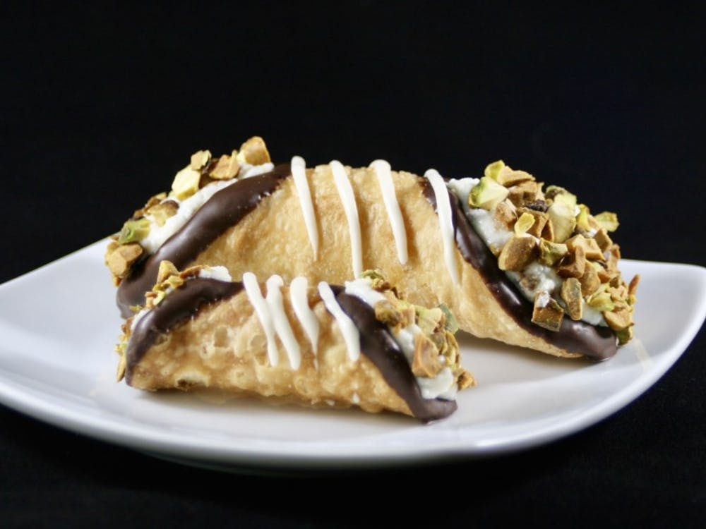 Michael and Christina Steigerwald founded Holy Moly Cannoli food truck, which serves a variety of rotating cannoli flavors.