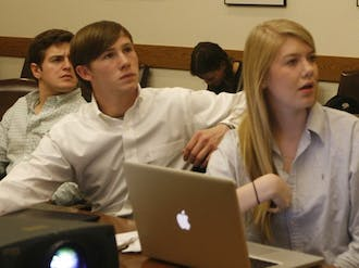 At Thursday's Campus Council meeting, Campus Council President Stephen Temple (center) listens to proposals to restore Saturday cleaning in dormitories.  RLHS says the decision came after a semester of complaints from students.